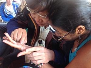 Muang giving Nina a hand.